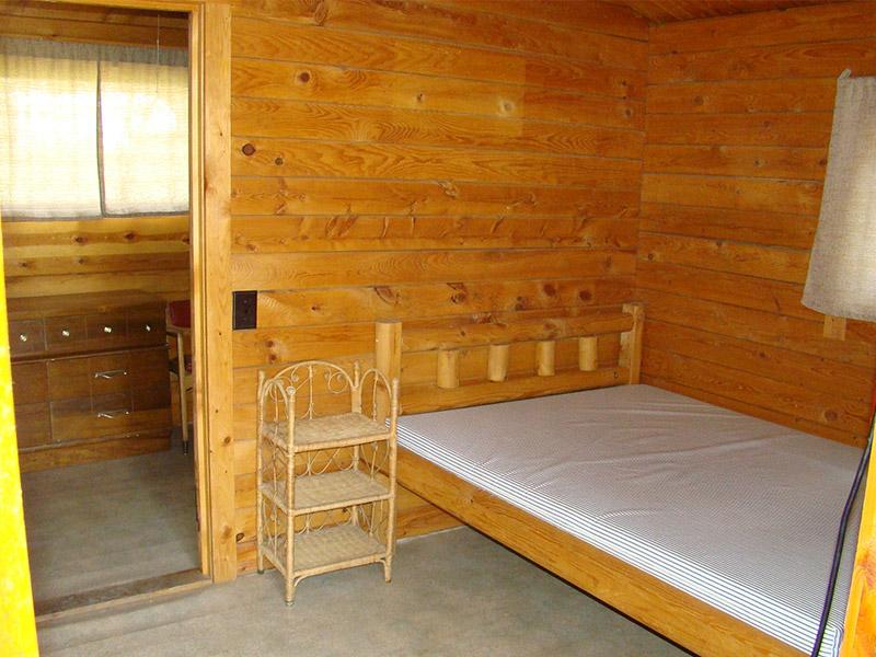 Full bed inside log cabin